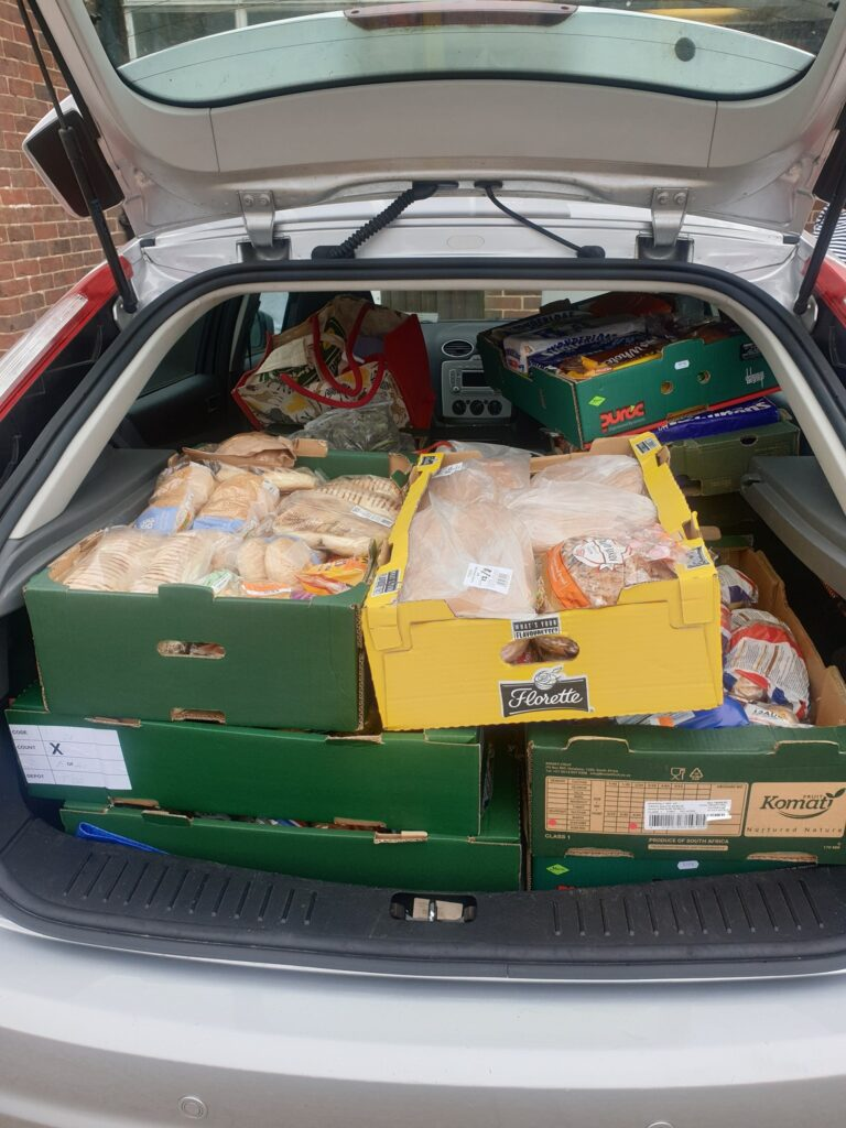 Car boot full of bread and pastries in boxes